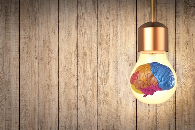 Idee maakt geldconcept met kleurrijke hersenen in gloeilamp en gouden munten