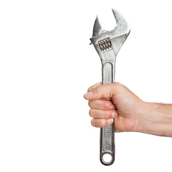 Iemands hand holding spanner