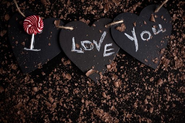 Ik hou van je, geschreven krijt op een schoolbord. fijne valentijnsdag.