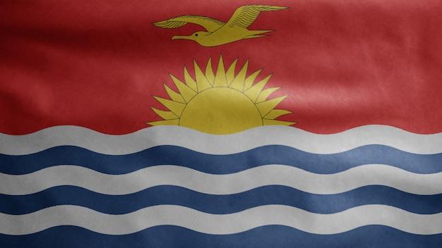 Ikiribati vlag zwaaien in de wind. close up van kirgizië banner waait, zacht en glad zijde. doek stof textuur vlag achtergrond. gebruik het voor het concept van nationale dag en landgelegenheden.