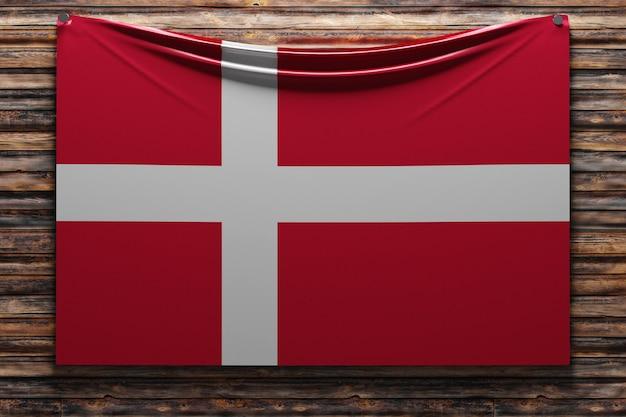 Illustratie van de nationale stoffenvlag van denemarken genageld op een houten muur