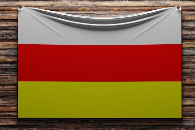Illustratie van de nationale stoffenvlag van ossetië genageld op een houten muur