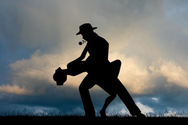 Illustratie van de tango bij zonsondergang