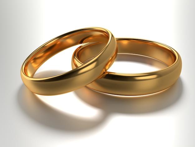 Illustratie van twee gouden trouwringen liggen in elkaar geïsoleerd op wit. 3d-weergave
