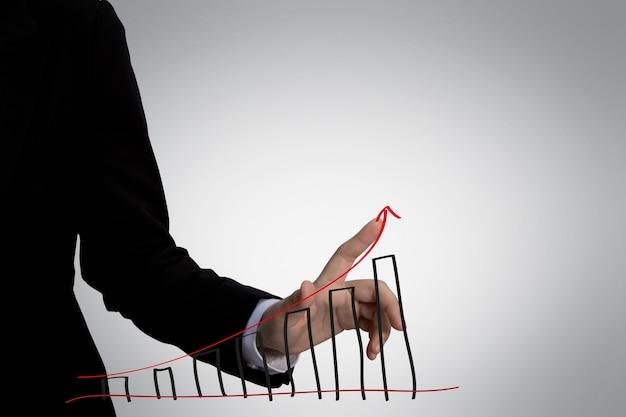Index vinger aanraken van een grafiek met een rode pijl