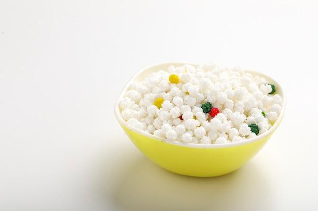Indian festival makar sankranti concept: tilgul in bowl