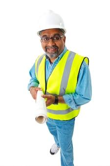 Indiase bouwvakker in reflecterend vest en bouwvakker bedrijf blauwdrukken