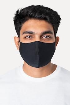 Indiase man in zwart masker nieuwe normale mode studio portret