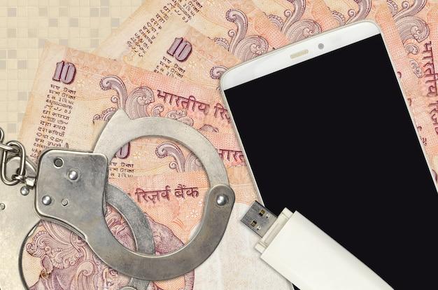Indiase roepiesrekeningen en smartphone met politiehandboeien