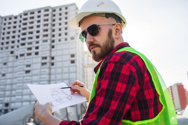 Ingenieur controle bouw site plannen
