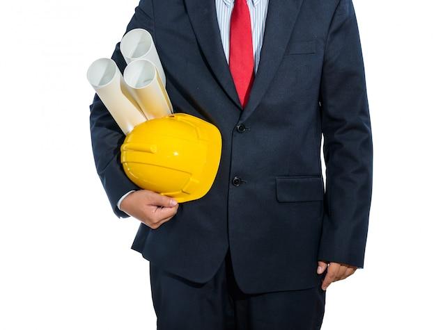 Ingenieur gele helm voor arbeidersveiligheid met geïsoleerde bouwplannen