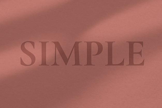 Ingeslagen teksteffect psd bewerkbare sjabloon op papier textuur terug