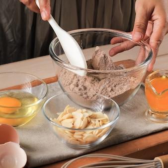 Ingrediënt van chocolate cake brownies in landelijke of rustieke keuken
