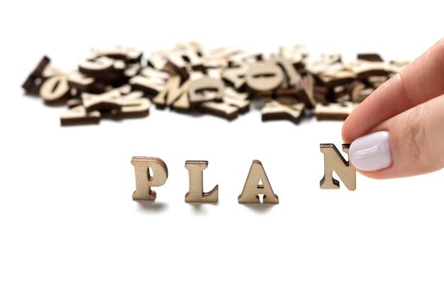 Inschrijvingsplanning geschreven houten brievenclose-up, het concept planning