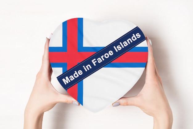 Inscriptie gemaakt in faeröer, de vlag van faeröer.