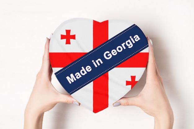 Inscriptie gemaakt in georgië, de vlag van georgië.