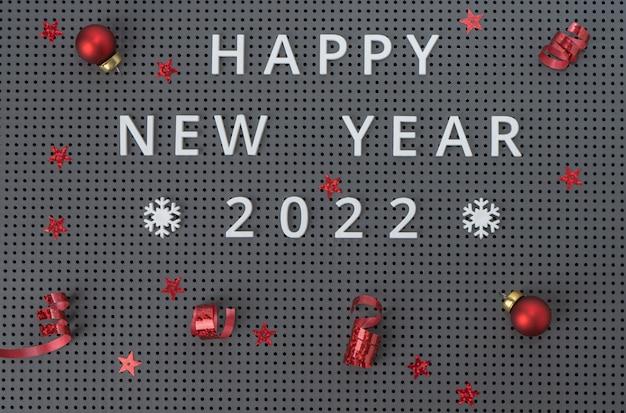 Inscriptie happy new year 2022 op grijze achtergrond met rode kerstversiering, confetti