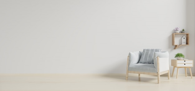 Interieur heeft een fauteuil op lege witte muur