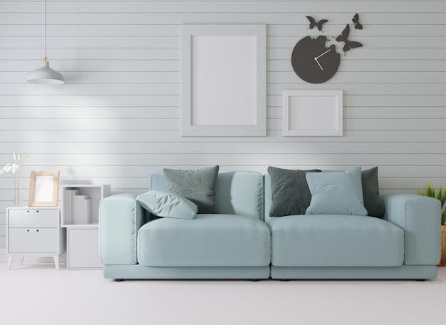 Interieur mockup in een witte kamer staat een blauwe bank naast een fotolijst aan de muur