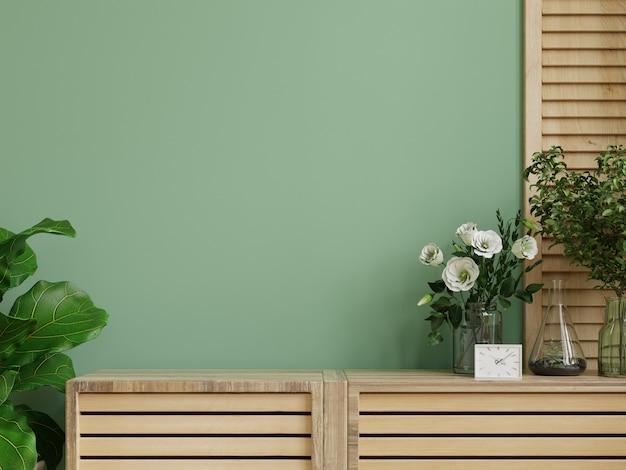 Interieurmuurmodel met groene plant, groene muur en plank. 3d-rendering