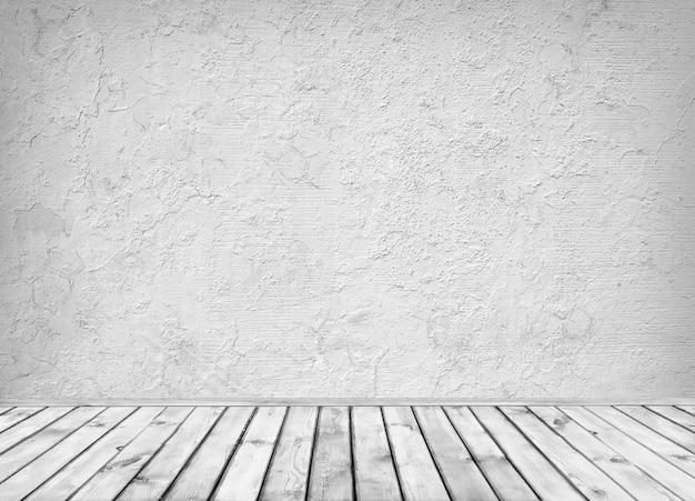 Interieurontwerp van grijze betonnen wand en houten vloer