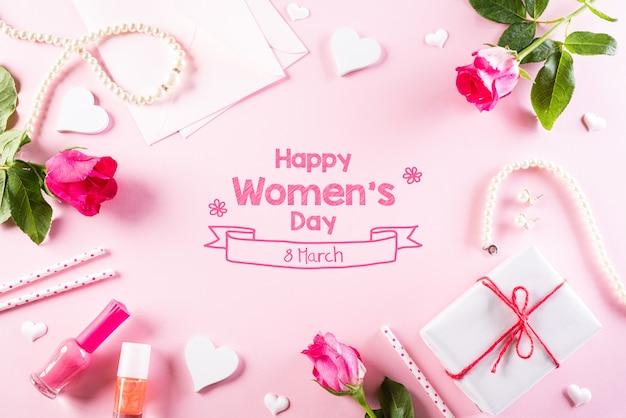 Internationale vrouwendag concept op roze pastel achtergrond.