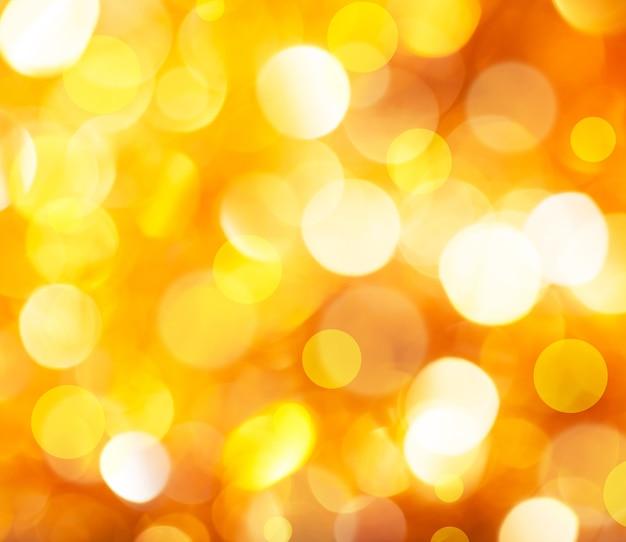 Intreepupil vintage gouden glanzende lichten kerst bokeh achtergrond