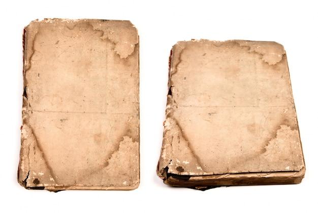 Inzameling van oude boeken geïsoleerd op wit