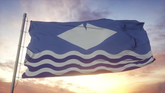 Isle wight vlag, engeland, zwaaien in de wind, lucht en zon achtergrond. 3d-rendering