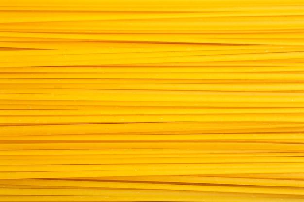 Italiaanse deegwarenachtergrond. spaghetti pasta close-up. achtergrondvoedsel