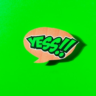 Ja tekst in tekstballon op groene achtergrond
