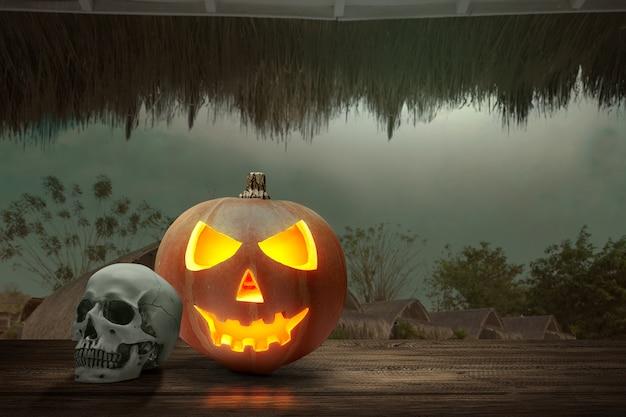 Jackolantern en menselijke schedel op houten tafel