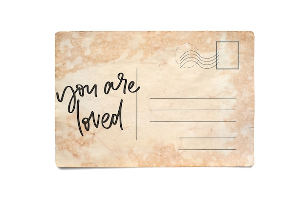 Je bent geliefd. belettering op een vintage briefkaart. geïsoleerd op wit.