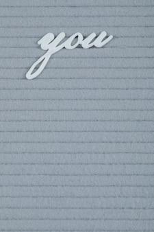 Je zin ingebed op een grijs weefsel
