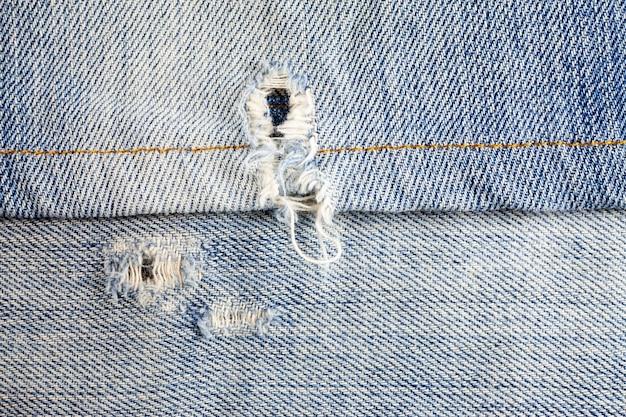 Jeans gescheurd denim textuur oppervlak. Premium Foto