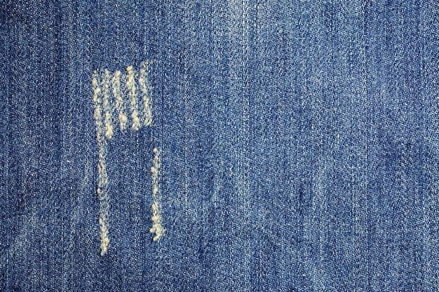 Jeans gescheurd denim textuur oppervlak.