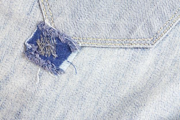Jeans gescheurd, denim textuur.