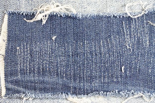 Jeans gescheurde achtergrond, denim textuur.