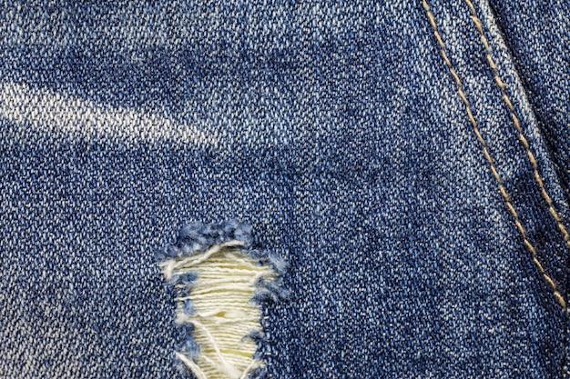 Jeans gescheurde denim textuur achtergrond. Premium Foto