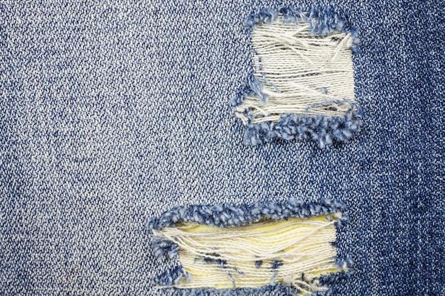 Jeans gescheurde denim textuur achtergrond.