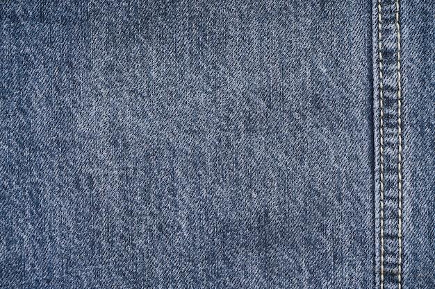 Jeansachtergrond, denim met naad van modevormgeving, ruimte voor tekst. plat leggen