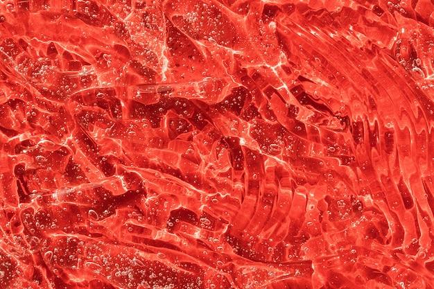 Jelly cleanser cosmetisch product rode moisturizer uitstrijkje smudge gel textuur met bubbels serum vloeistof