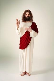 Jezus toont het symbool van vrede