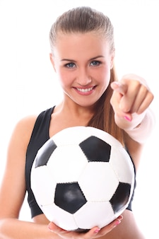 Jong en sexy meisje met voetbal