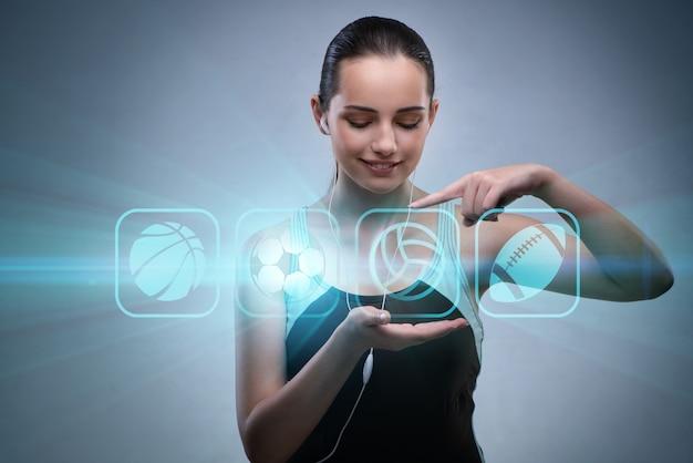 Jong meisje in sportenconcept die virtuele knopen drukken