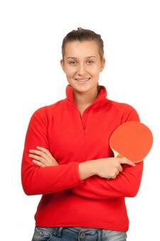 Jong meisje met een racket pingpong geïsoleerd op wit