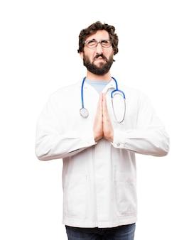 Jonge arts man bidden