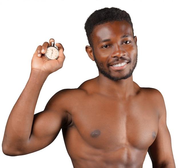 Jonge atleet die op wit wordt geïsoleerd
