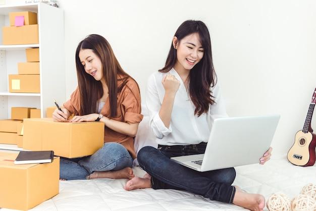 Jonge aziatische vrouw opstarten kleine bedrijven ondernemer mkb distributie magazijn met parc