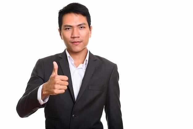 Jonge aziatische zakenman duim opgevend